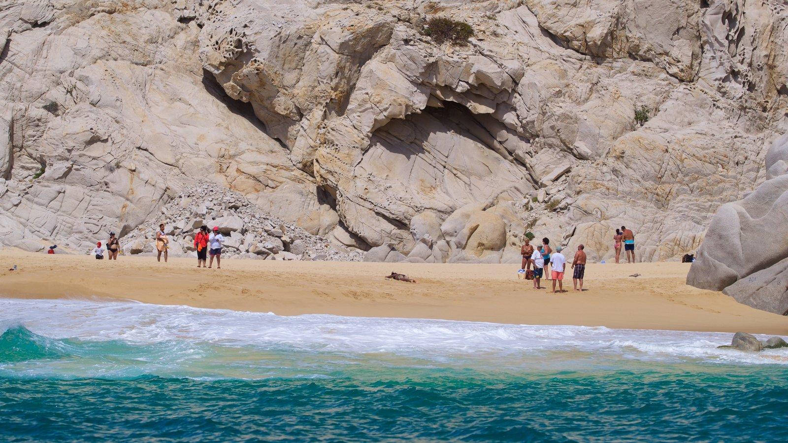 Playa Divorce que incluye una playa de arena, costa escarpada y vistas generales de la costa