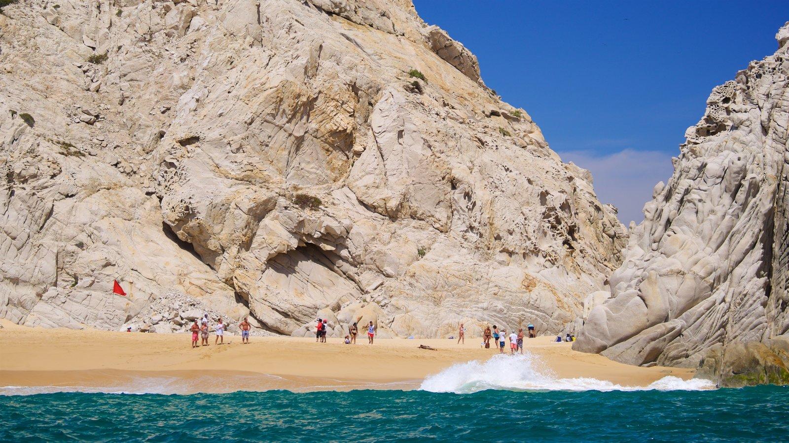 Playa Divorce ofreciendo costa escarpada, vistas generales de la costa y una playa de arena