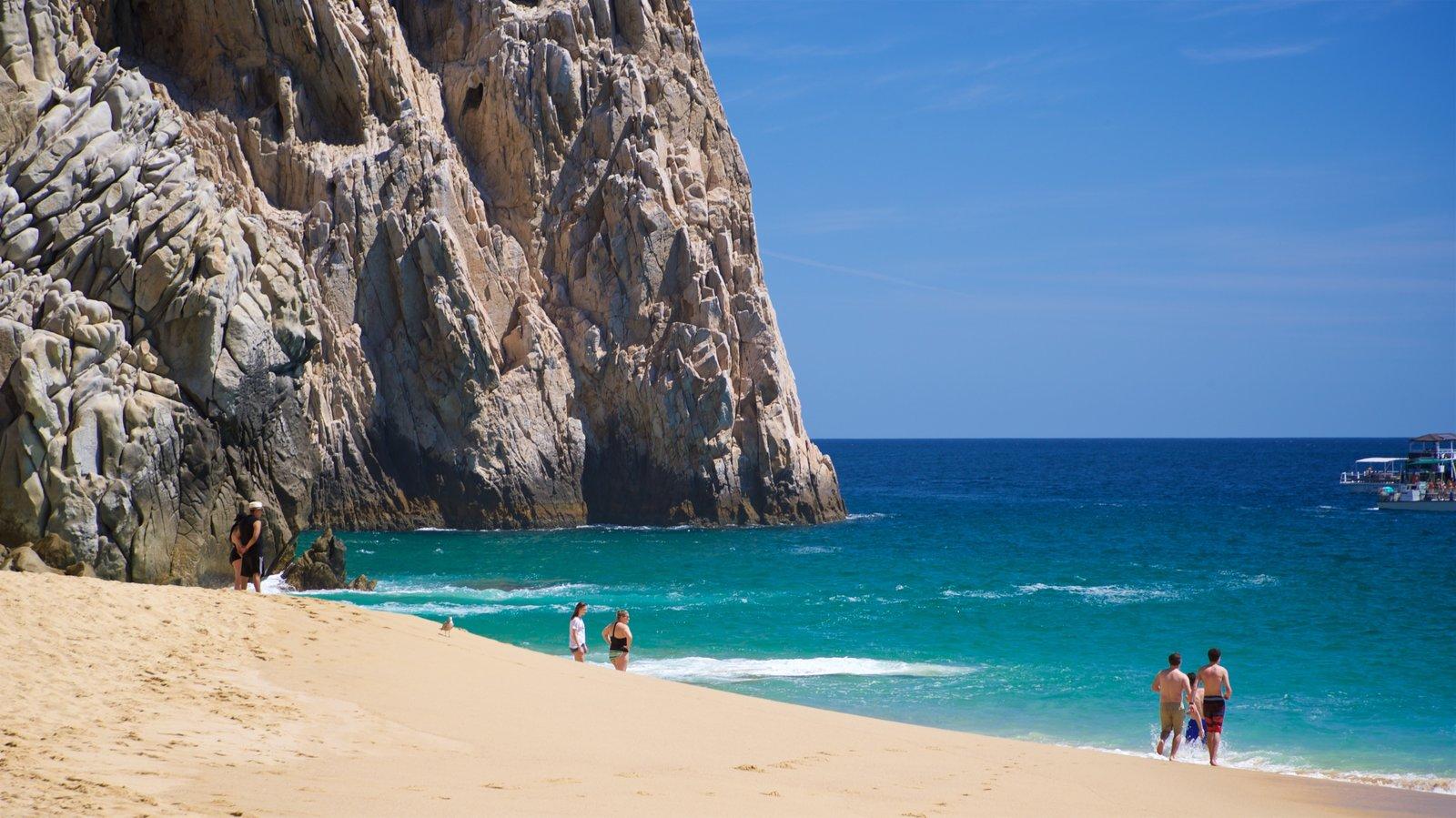 Playa Divorce mostrando vistas generales de la costa, costa escarpada y una playa de arena