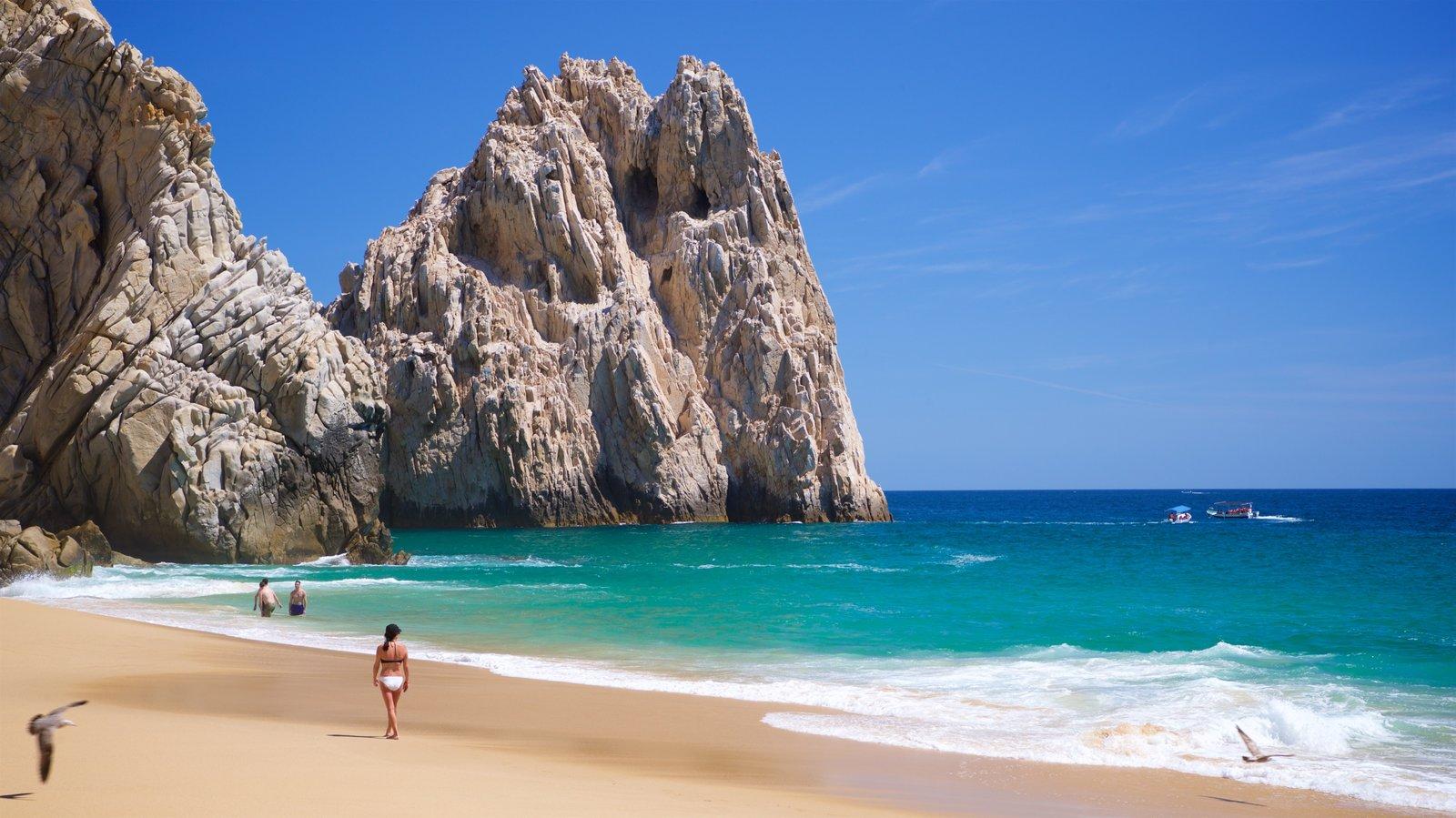 Playa Divorce mostrando una playa de arena, costa rocosa y vistas generales de la costa