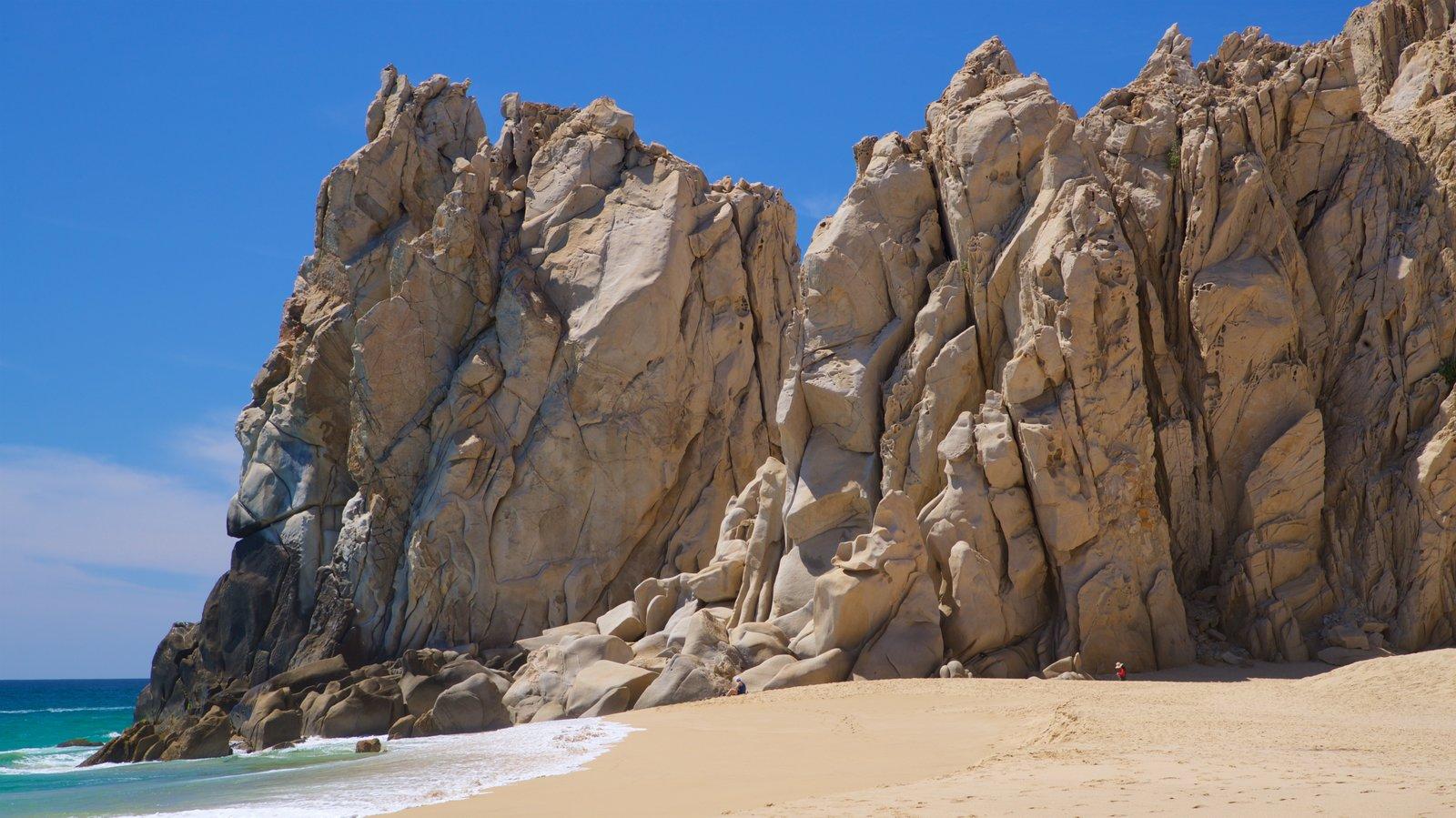 Playa Divorce ofreciendo costa rocosa, vistas generales de la costa y una playa