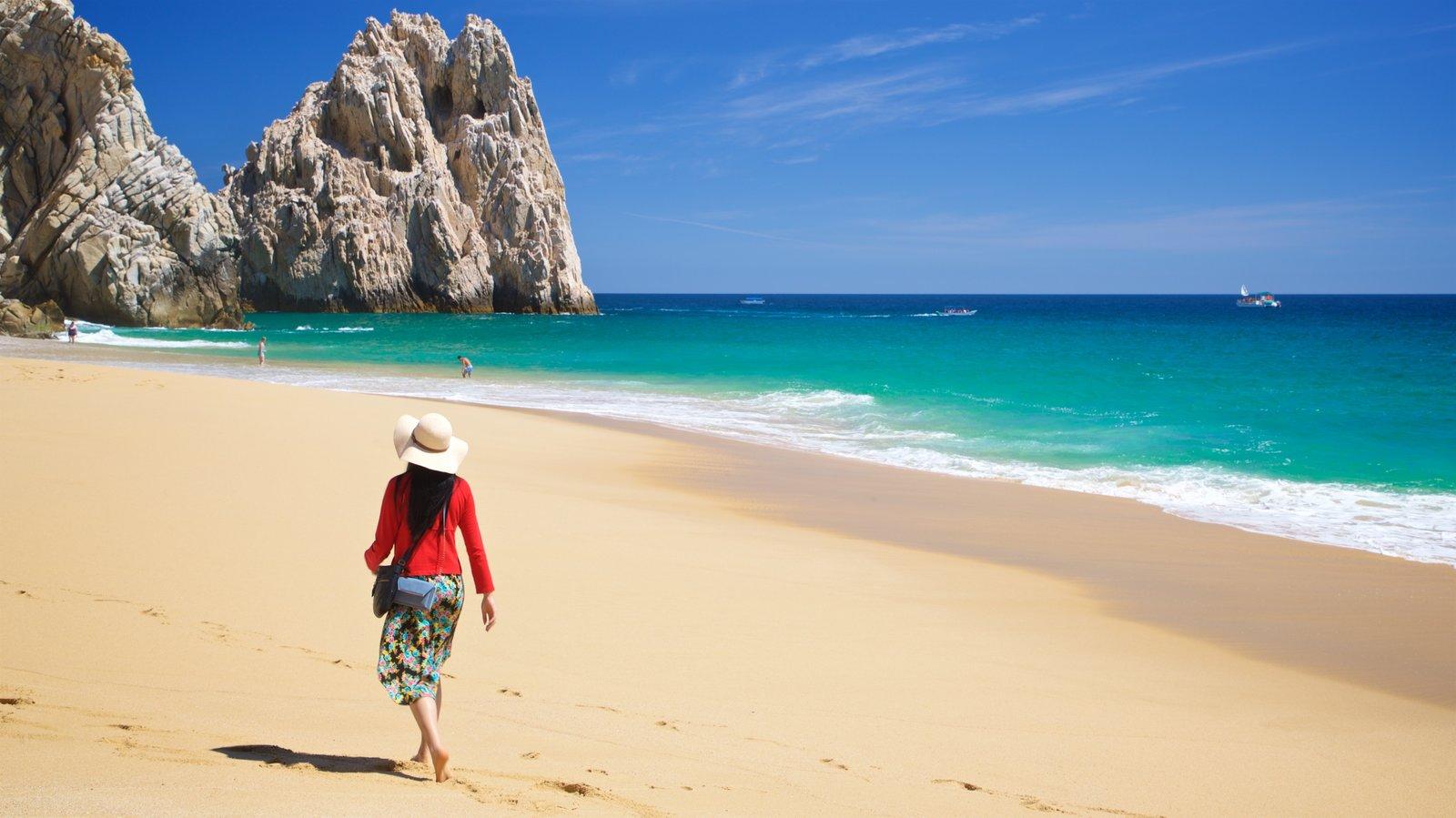 Playa Divorce ofreciendo vistas generales de la costa, costa rocosa y una playa