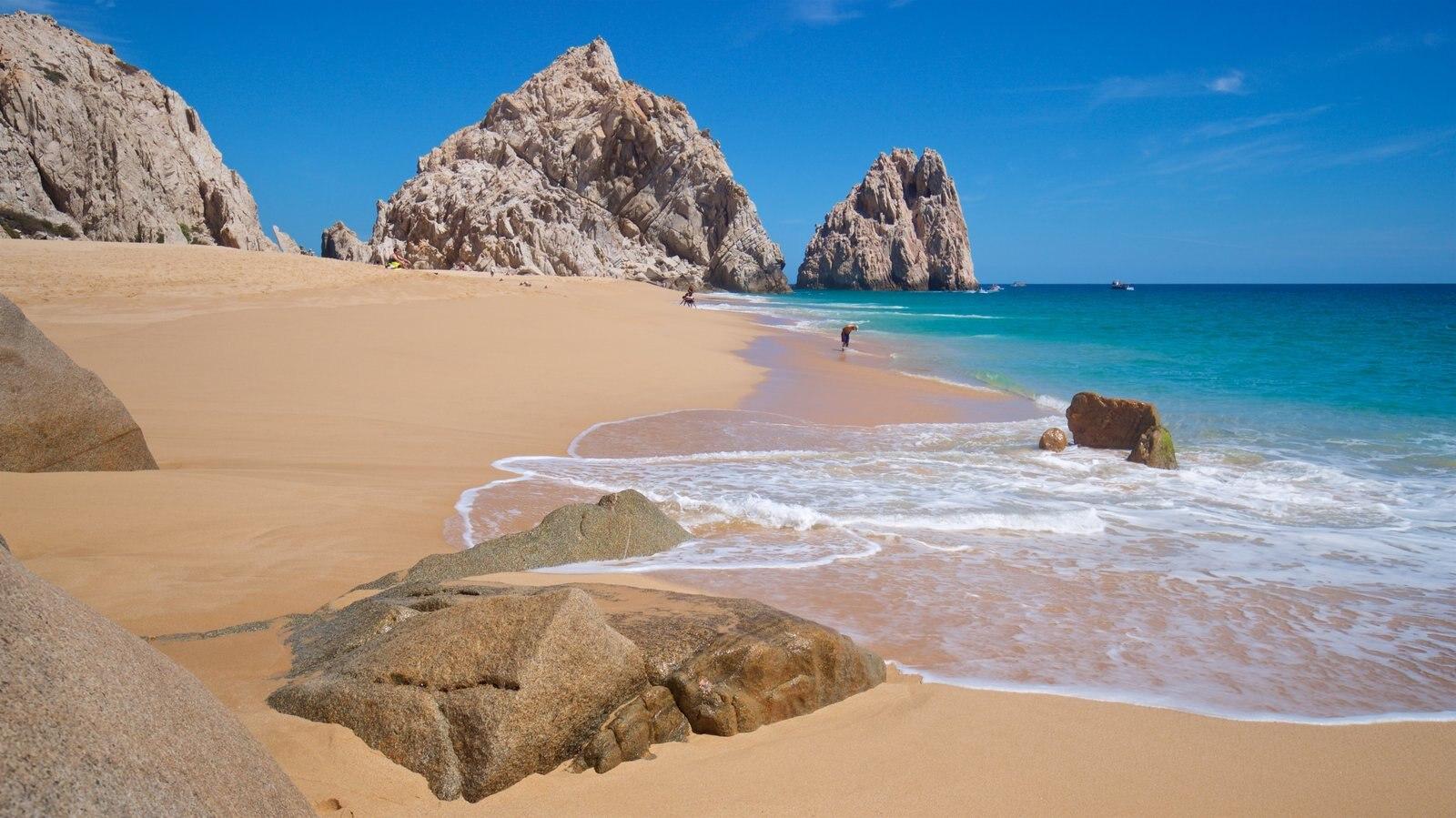 Playa Divorce mostrando una playa, vistas generales de la costa y costa rocosa