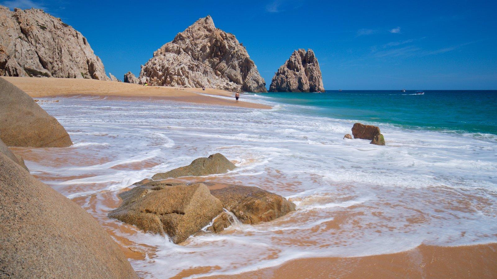 Playa Divorce ofreciendo una playa de arena, costa escarpada y vistas generales de la costa