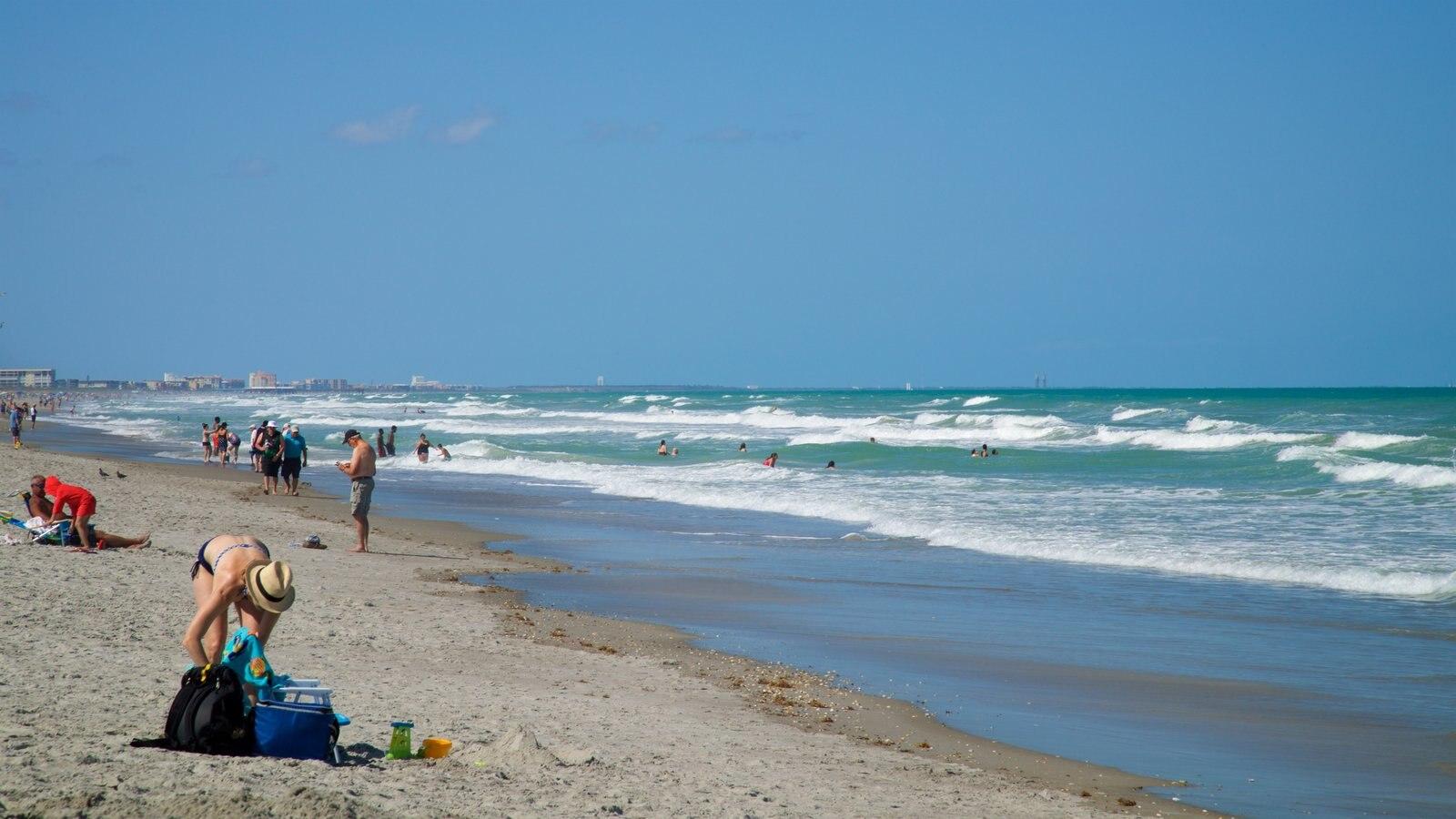 Cocoa Beach showing a beach and general coastal views as well as an individual femail