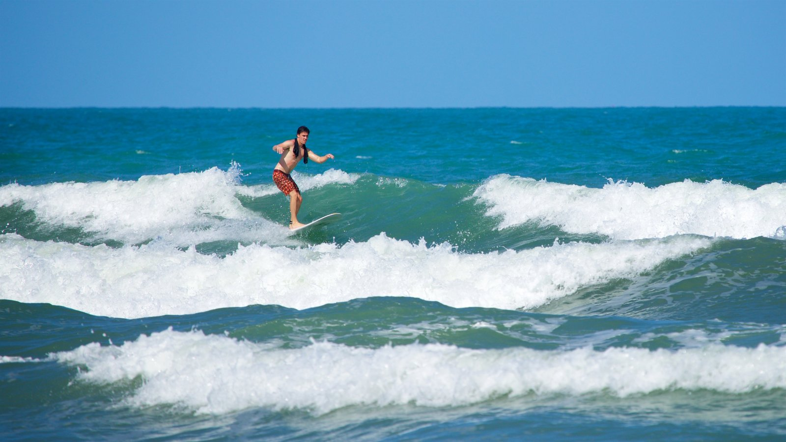 Cocoa Beach showing surfing, general coastal views and waves