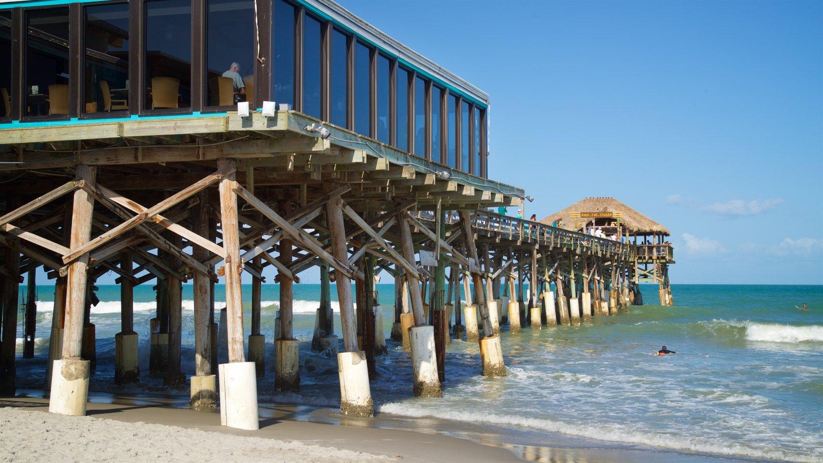 Cocoa Beach Pier which includes a sandy beach and general coastal views