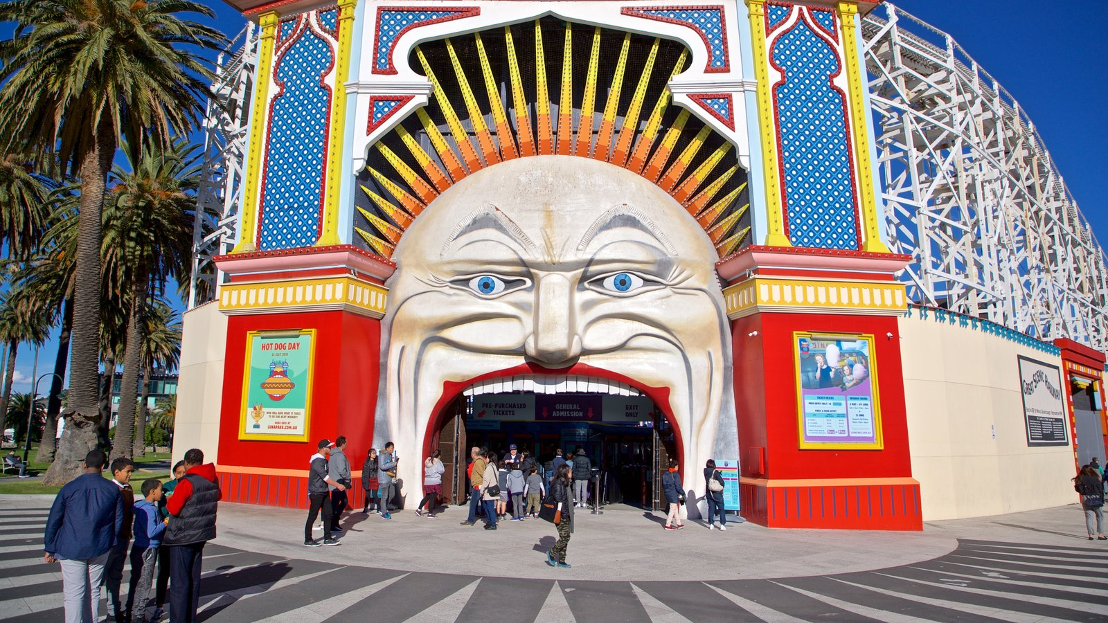 Luna Park showing signage, outdoor art and rides