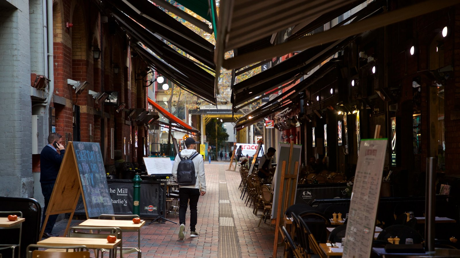 Hardware Lane featuring street scenes as well as an individual male