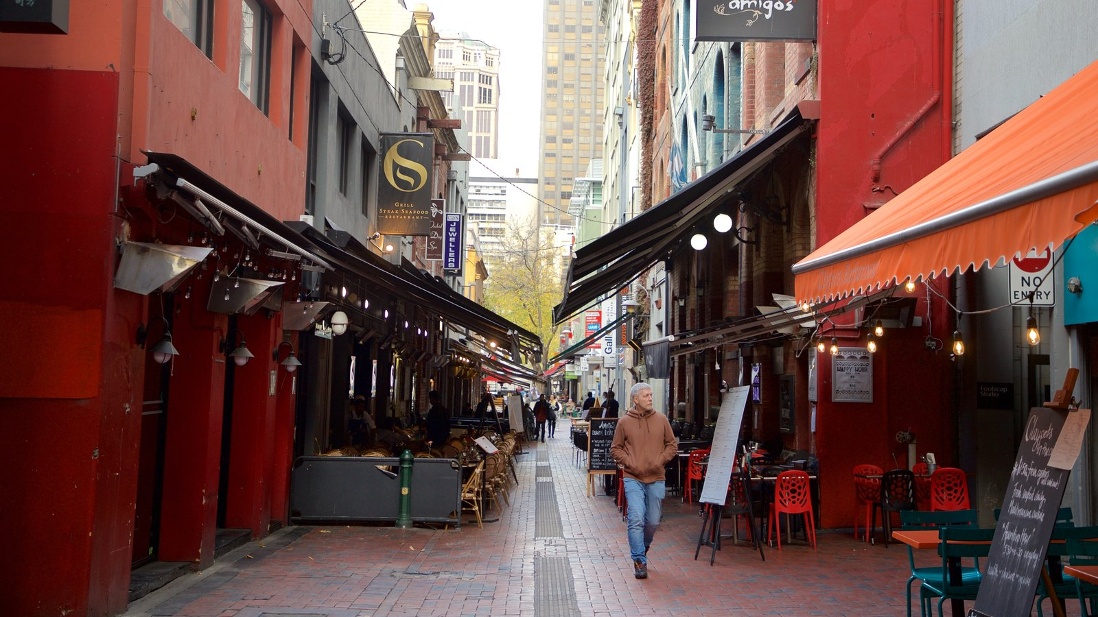 Hardware Lane showing street scenes as well as an individual male