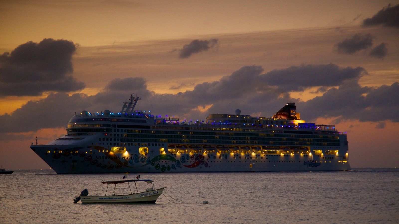 Cozumel showing a sunset, a bay or harbour and cruising