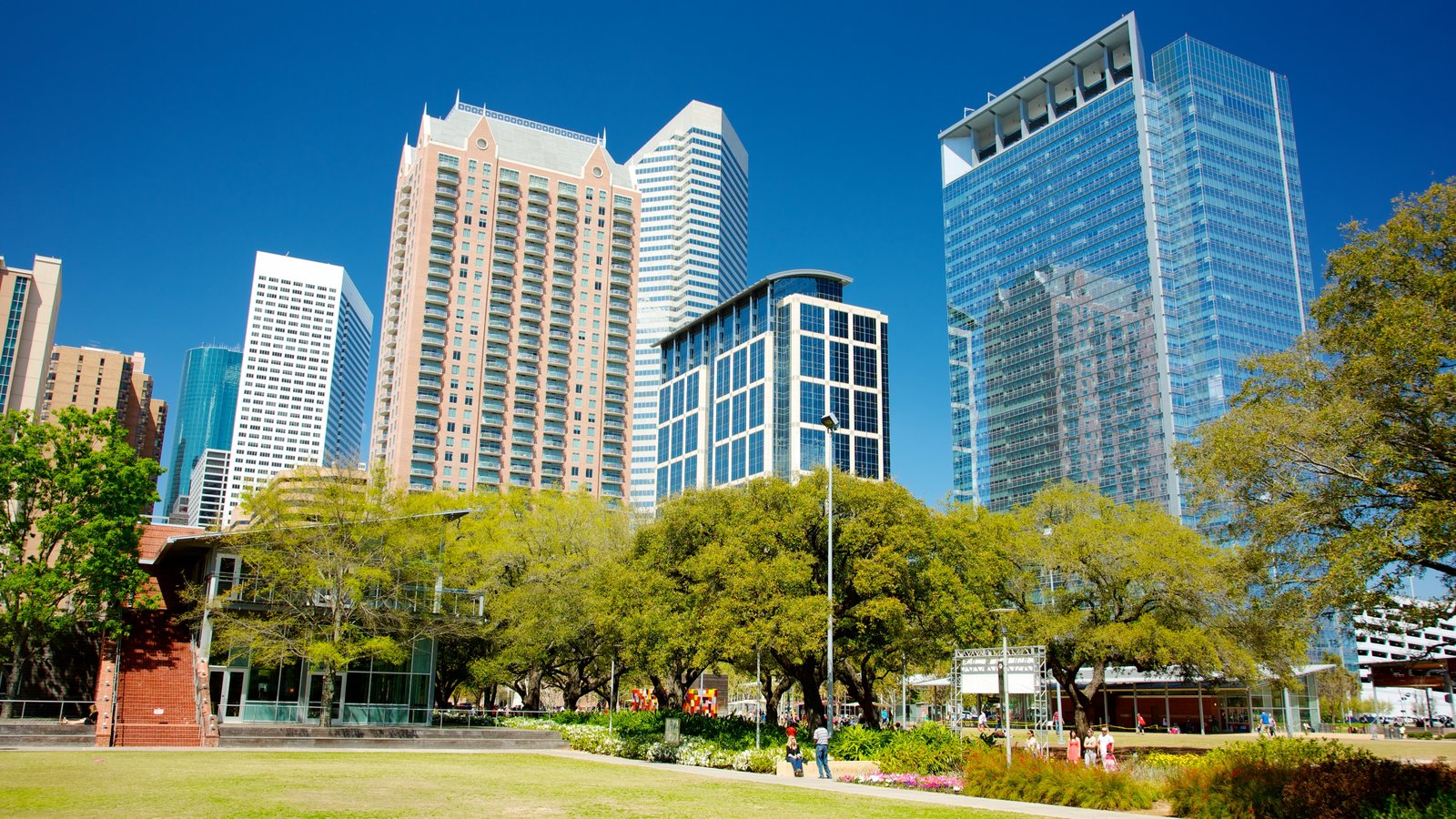 Discovery Green showing a high rise building, a garden and street scenes