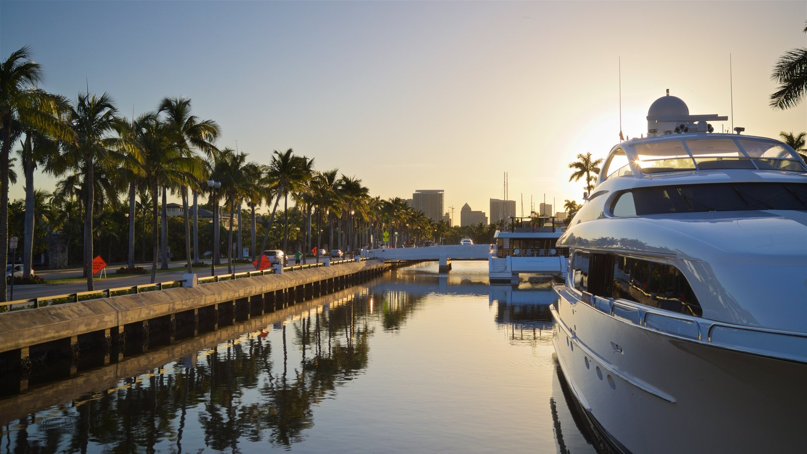 Las Olas Riverfront featuring a sunset and a bay or harbor
