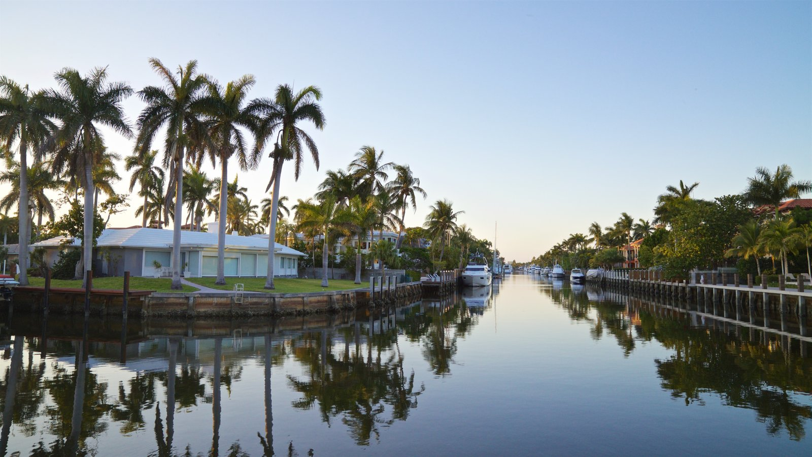 Las Olas Riverfront featuring a sunset, a river or creek and a house