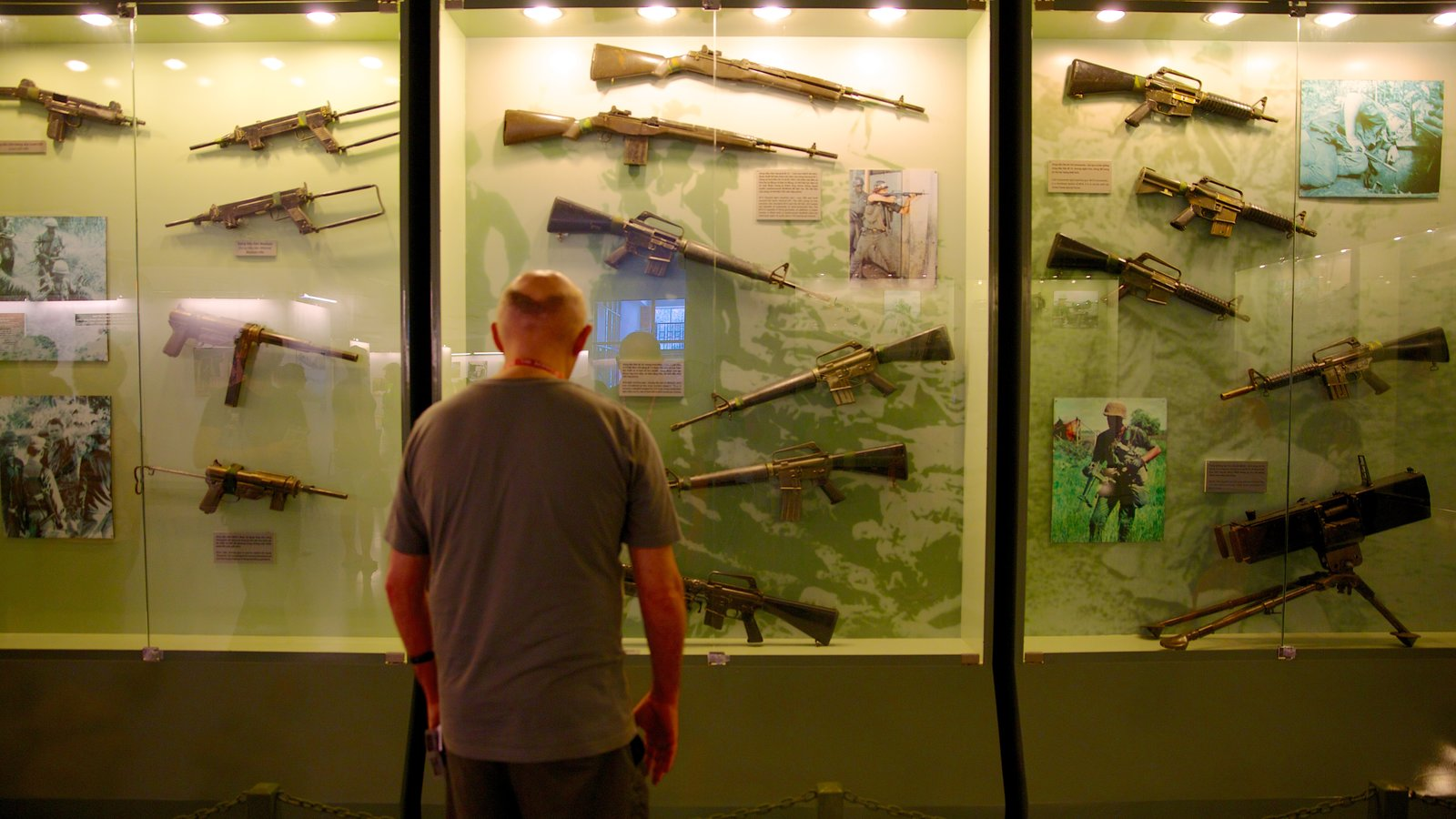 War Remnants Museum featuring military items and interior views as well as an individual male