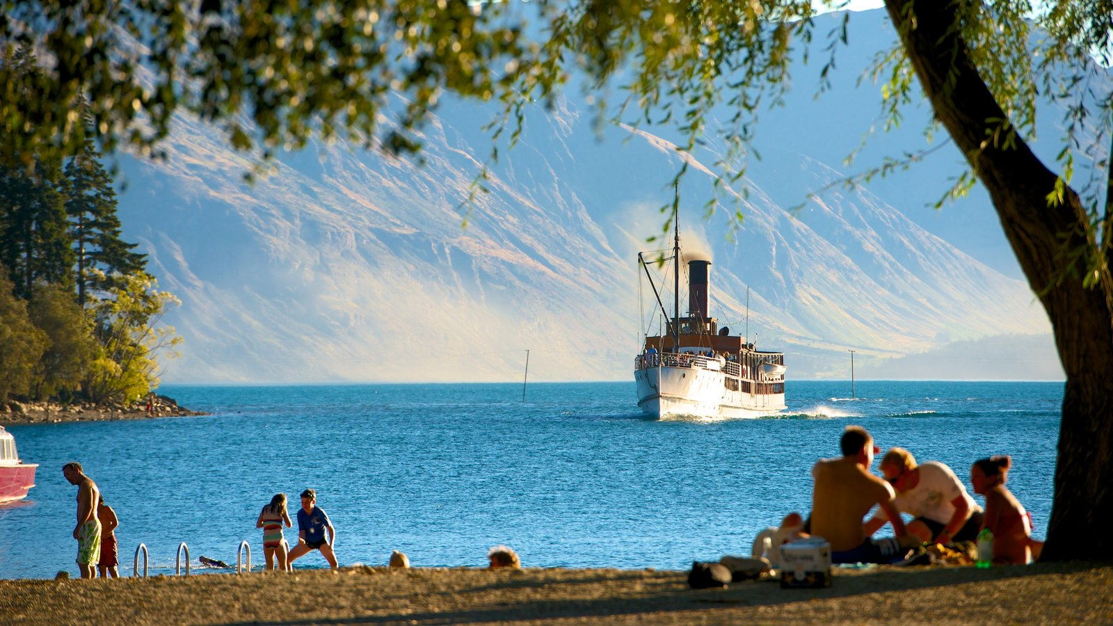 TSS Earnslaw Steamship showing picnicking, a bay or harbour and a sandy beach