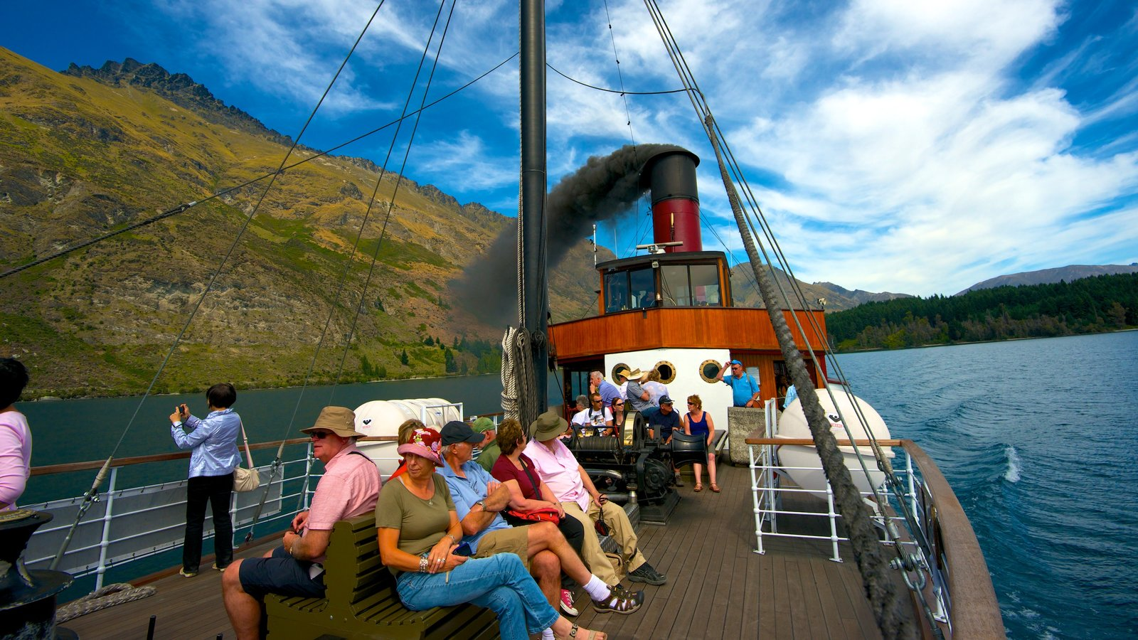 TSS Earnslaw Steamship showing boating and general coastal views as well as a large group of people