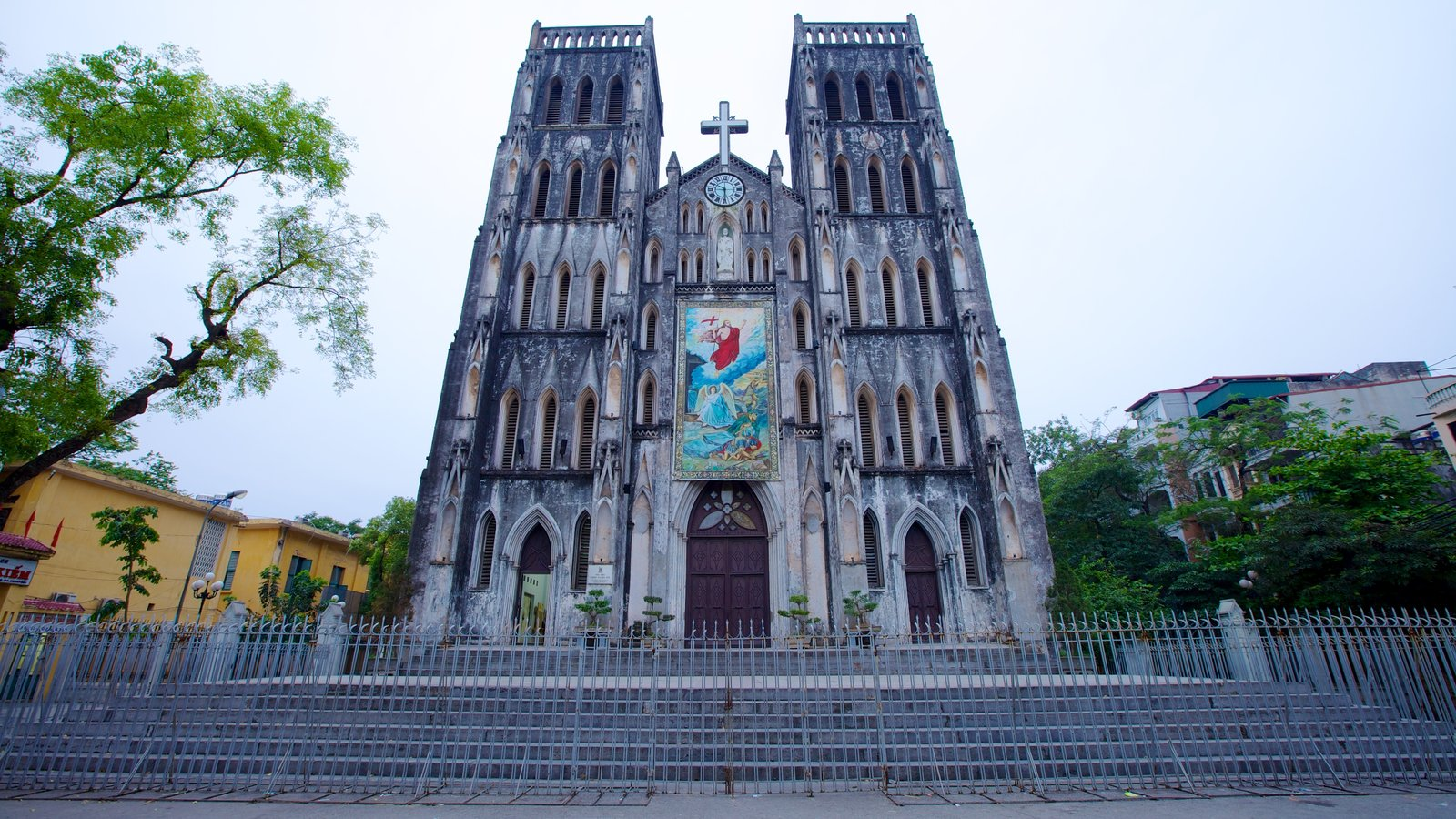 St. Joseph Cathedral which includes religious elements, a church or cathedral and a city
