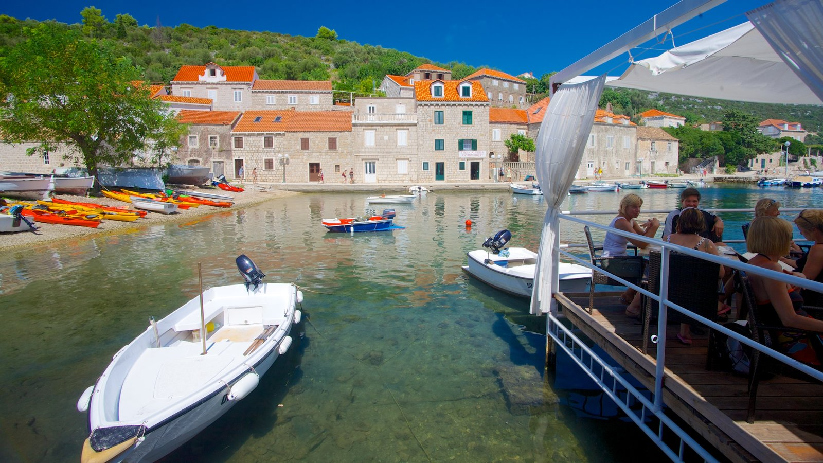Dubrovnik - Southern Dalmatia which includes a bay or harbor, a coastal town and boating