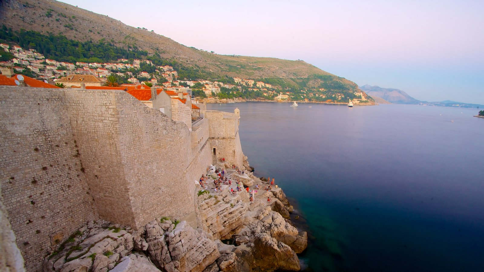 Dubrovnik - Southern Dalmatia featuring a coastal town, rugged coastline and heritage architecture