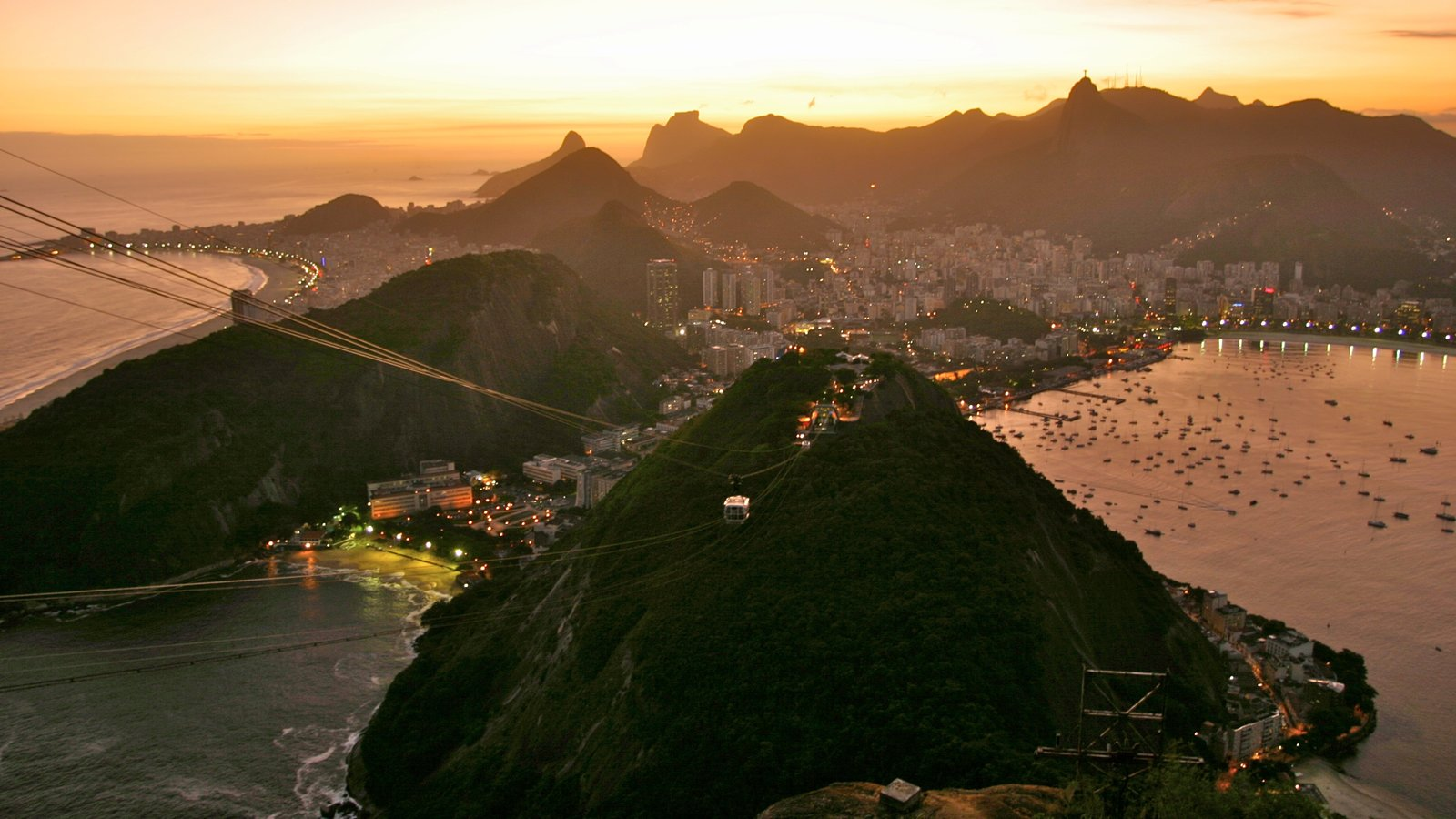 Rio de Janeiro which includes general coastal views, a sunset and mountains