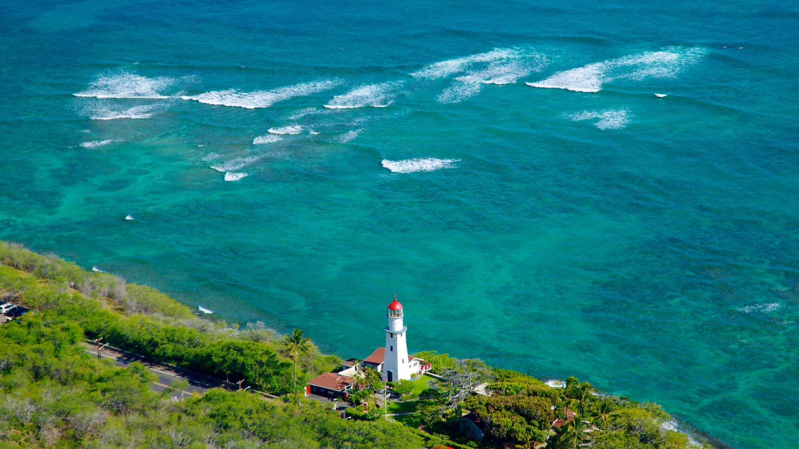 Diamond Head featuring tropical scenes, landscape views and a lighthouse