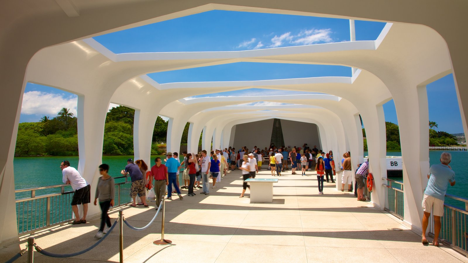 USS Arizona Memorial featuring views as well as a large group of people
