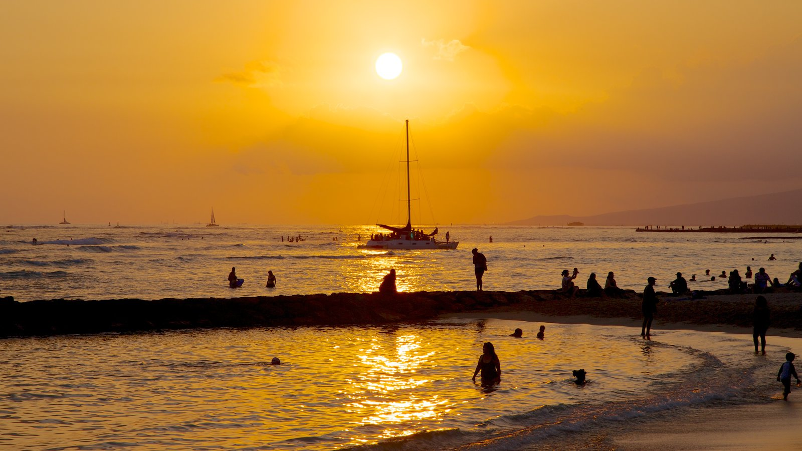 Waikiki Beach which includes a sunset, swimming and landscape views