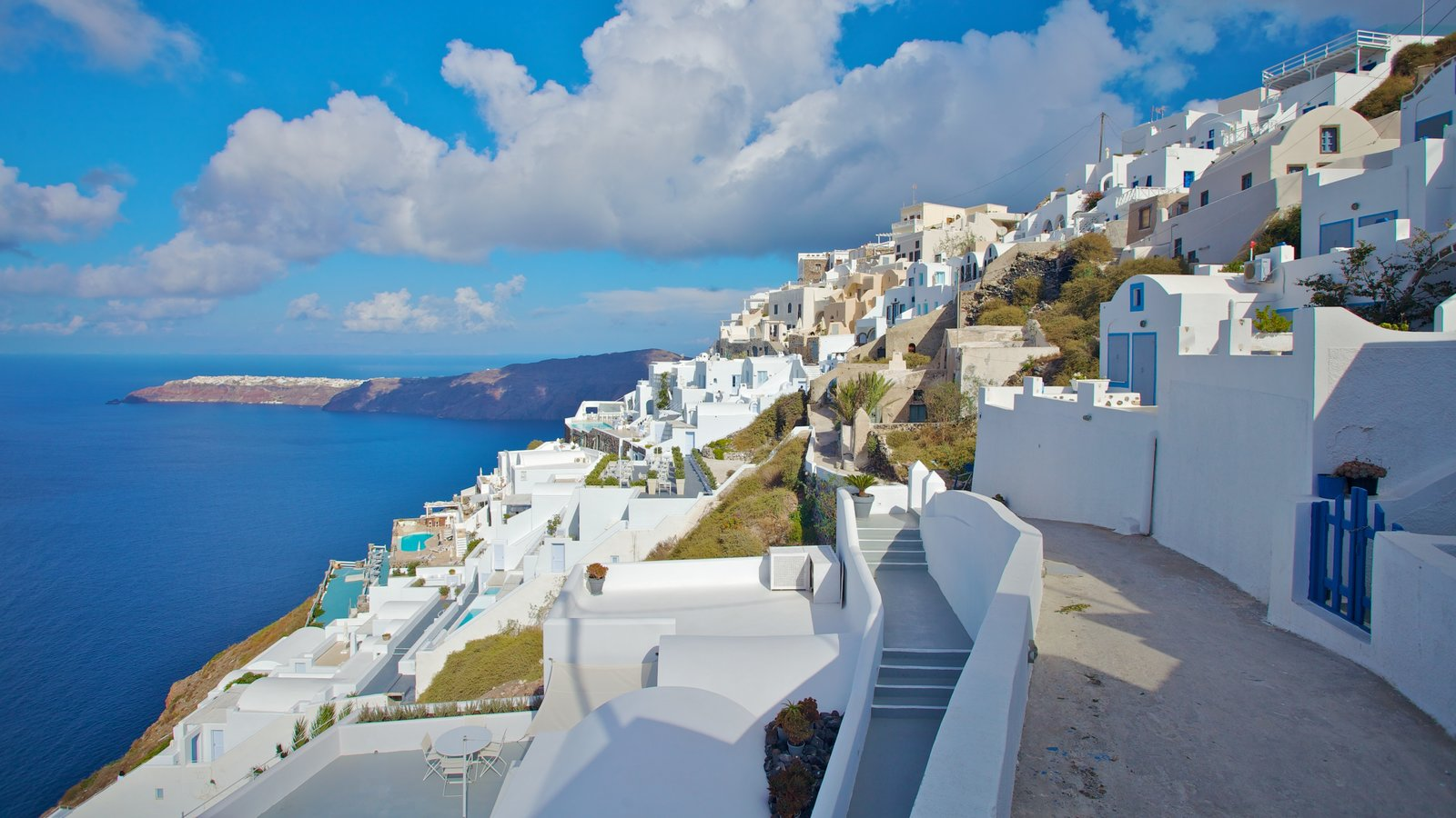 Fira featuring a coastal town and general coastal views