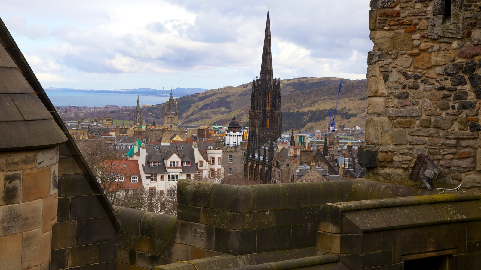 Edinburgh Castle featuring heritage architecture, chateau or palace and a small town or village
