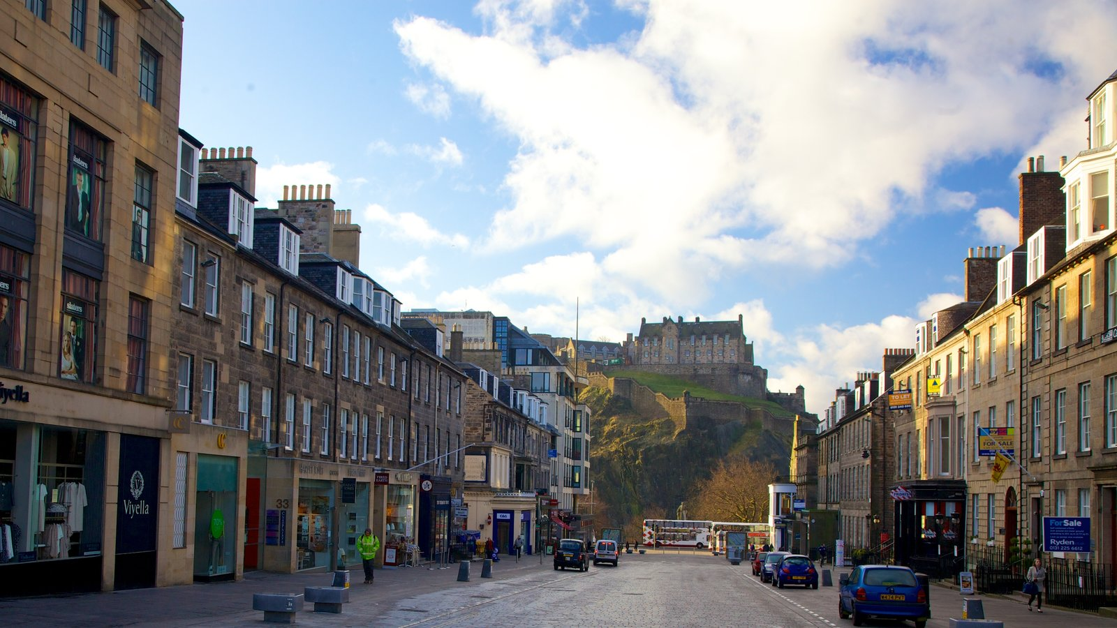 Edinburgh Castle which includes chateau or palace, a city and street scenes
