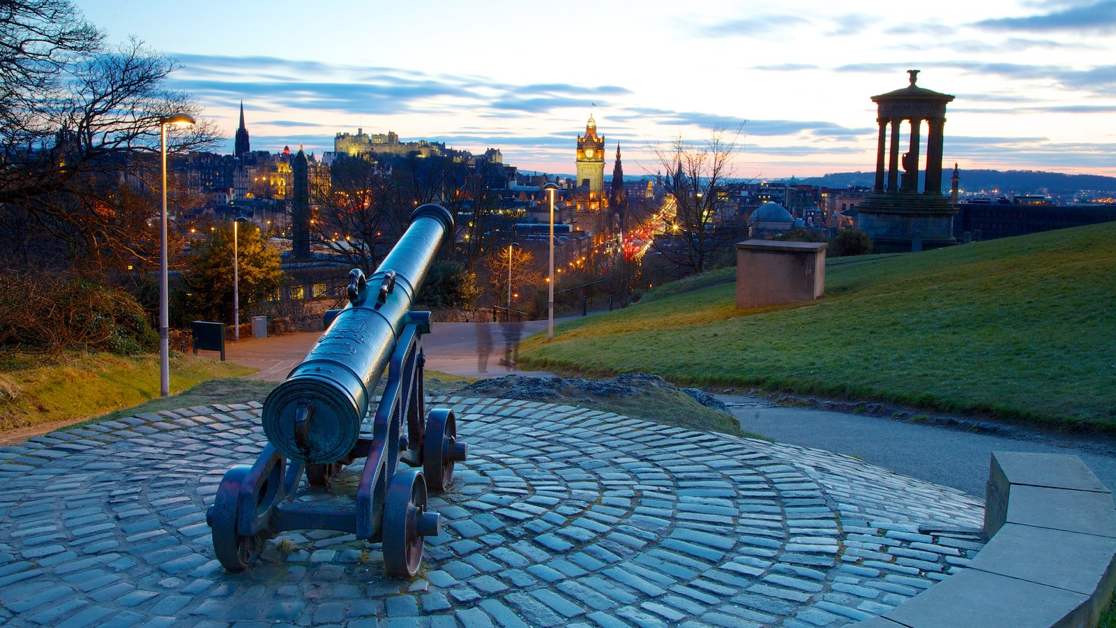 Calton Hill which includes a sunset and military items