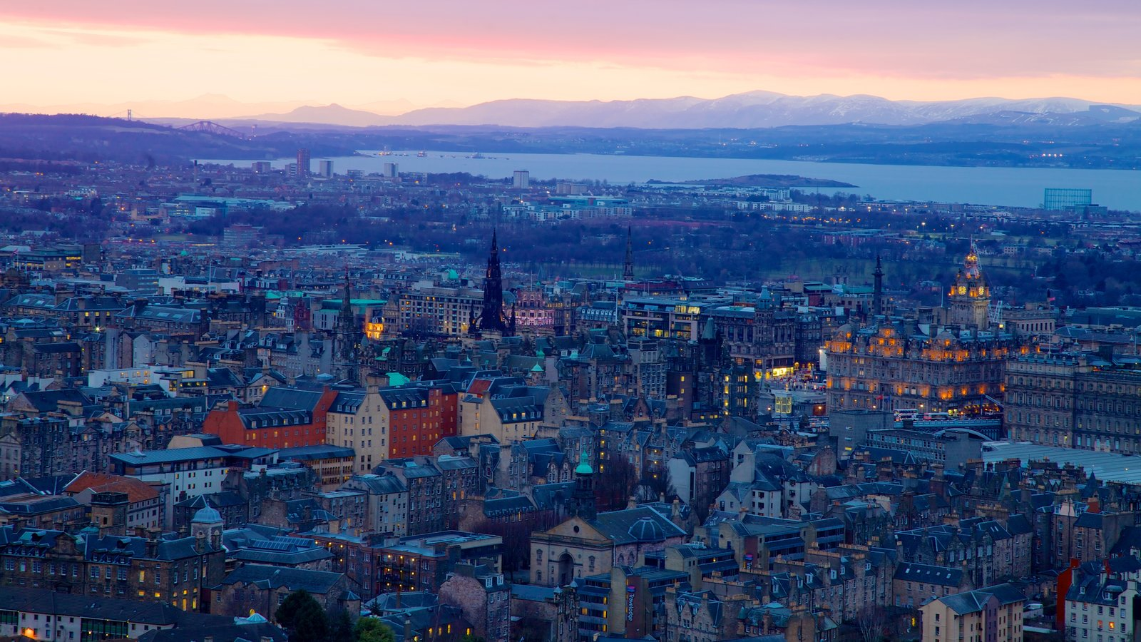 Arthur\\\'s Seat featuring a sunset and a city