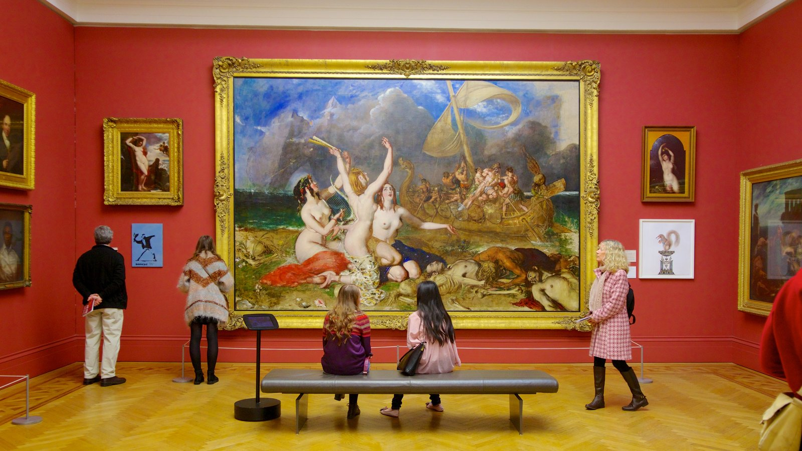 Manchester Art Gallery showing art and interior views as well as a small group of people