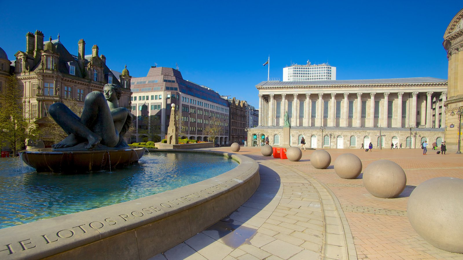 Victoria Square showing a pond, a statue or sculpture and a square or plaza