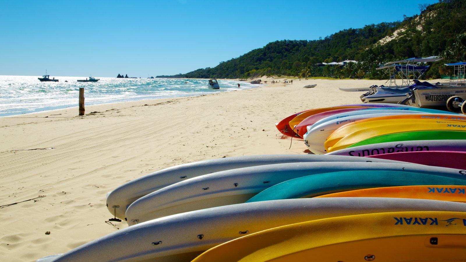 Parque nacional de Isla Moreton que incluye una playa de arena y escenas tropicales
