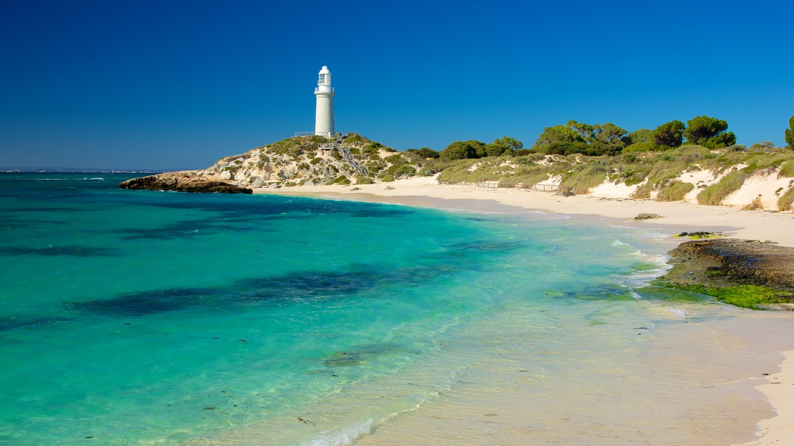 Rottnest Island showing landscape views, a lighthouse and a beach