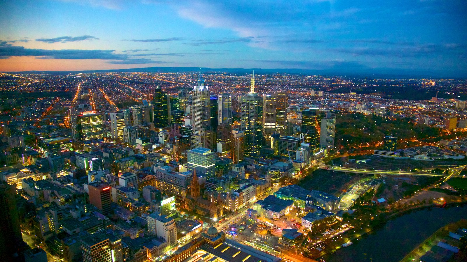 Eureka Tower which includes central business district, a high rise building and a sunset