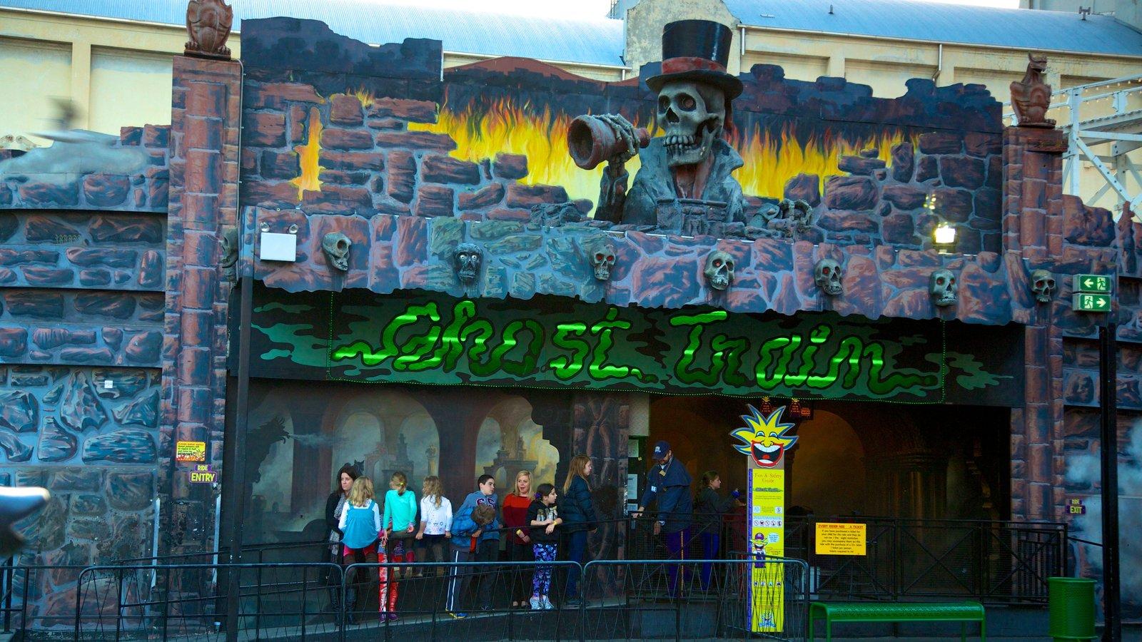 Luna Park showing art, rides and signage