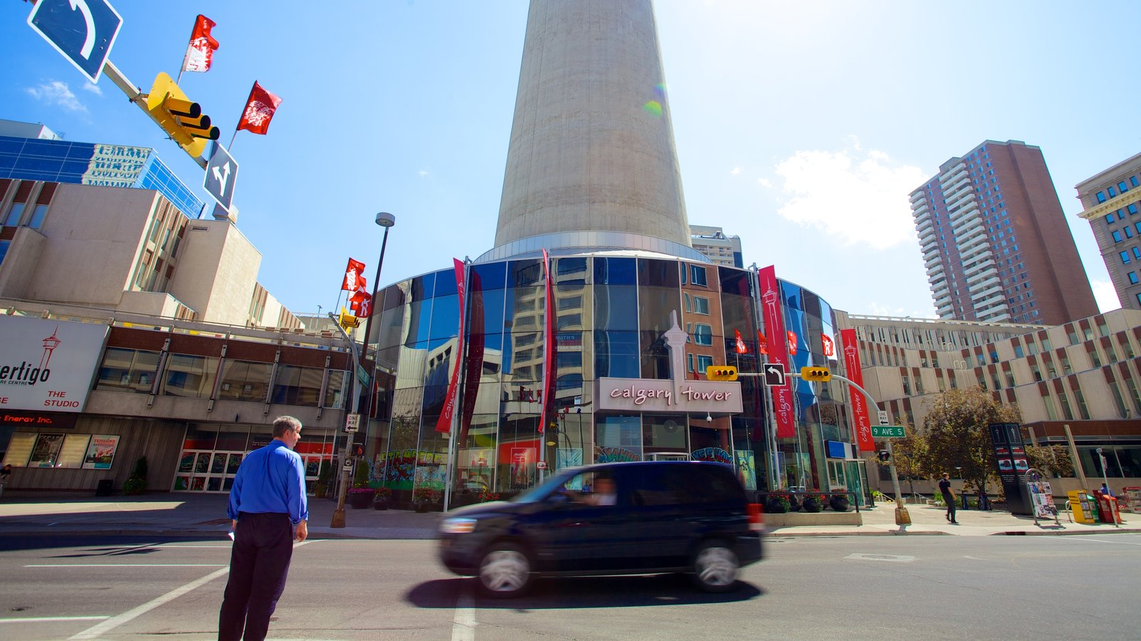 Calgary Tower which includes a city and street scenes as well as an individual male