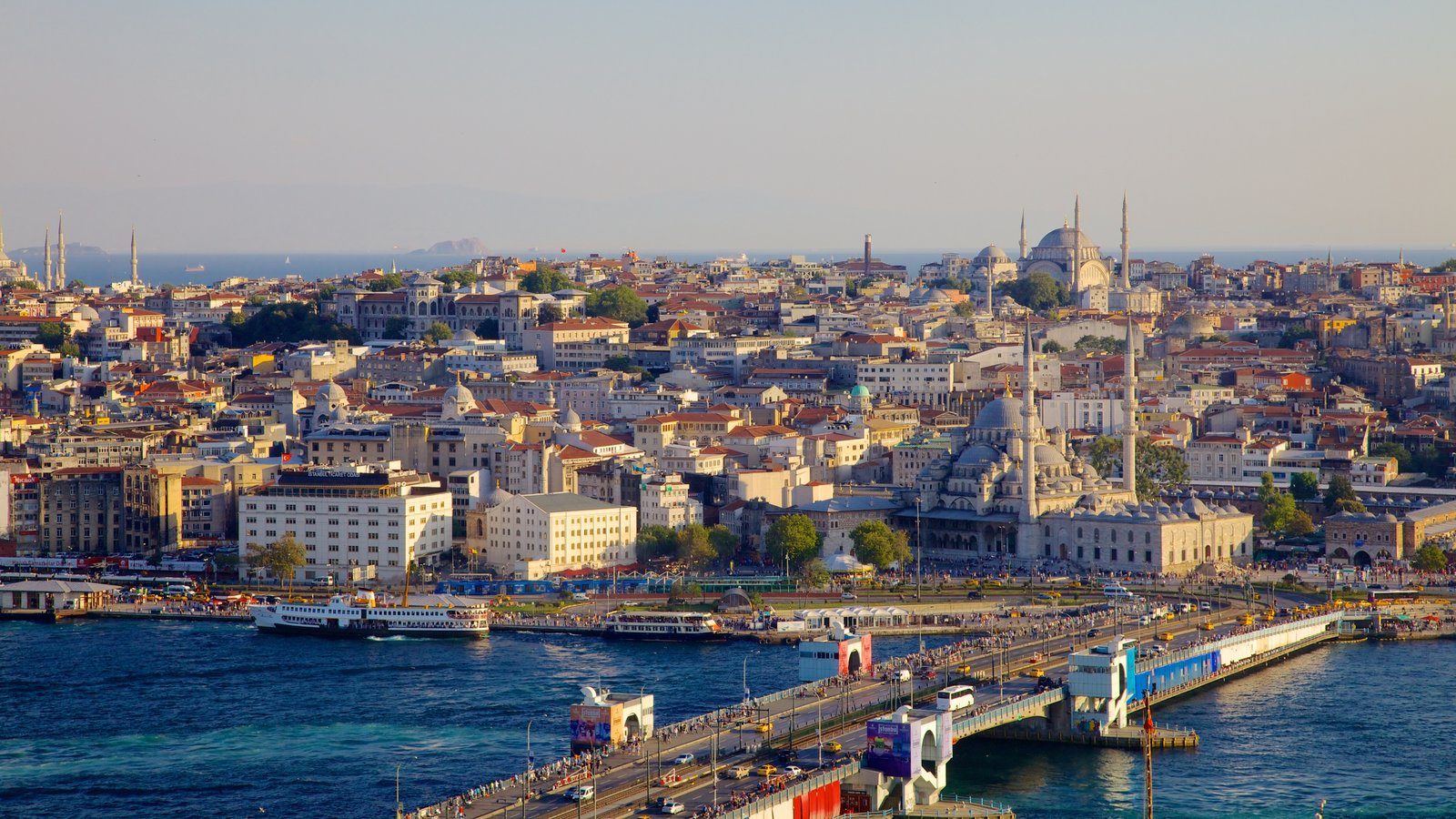 Galata Tower showing a river or creek, a bridge and skyline