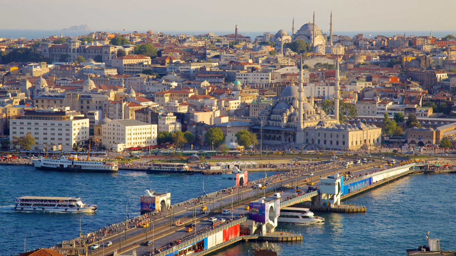 Galata Tower featuring a bridge, a river or creek and a ferry