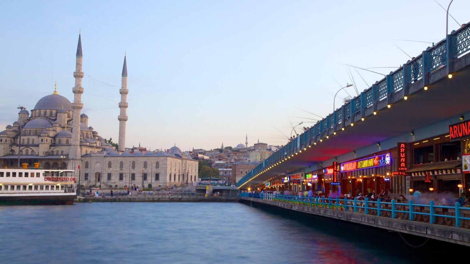Galata Bridge featuring a church or cathedral, cafe lifestyle and heritage architecture