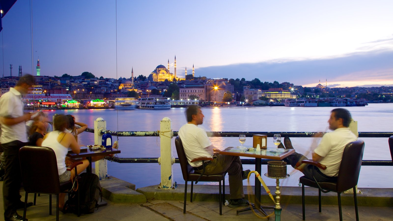 Galata Bridge which includes cafe lifestyle, a coastal town and a bay or harbor
