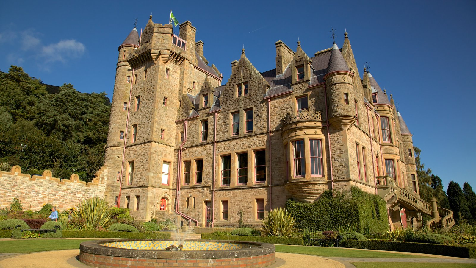 Belfast Castle which includes heritage architecture, a fountain and a castle