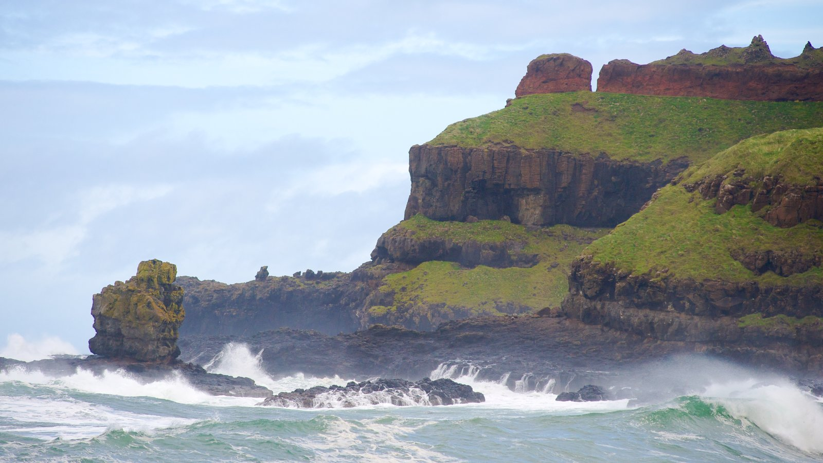 Giant\'s Causeway featuring rocky coastline, surf and general coastal views