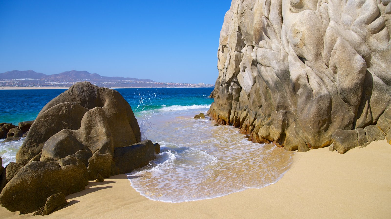 Lover\'s Beach featuring a sandy beach and rugged coastline