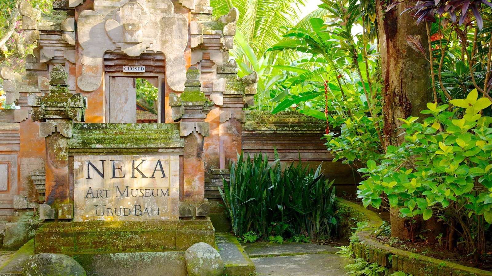 Neka Art Museum which includes a garden and signage
