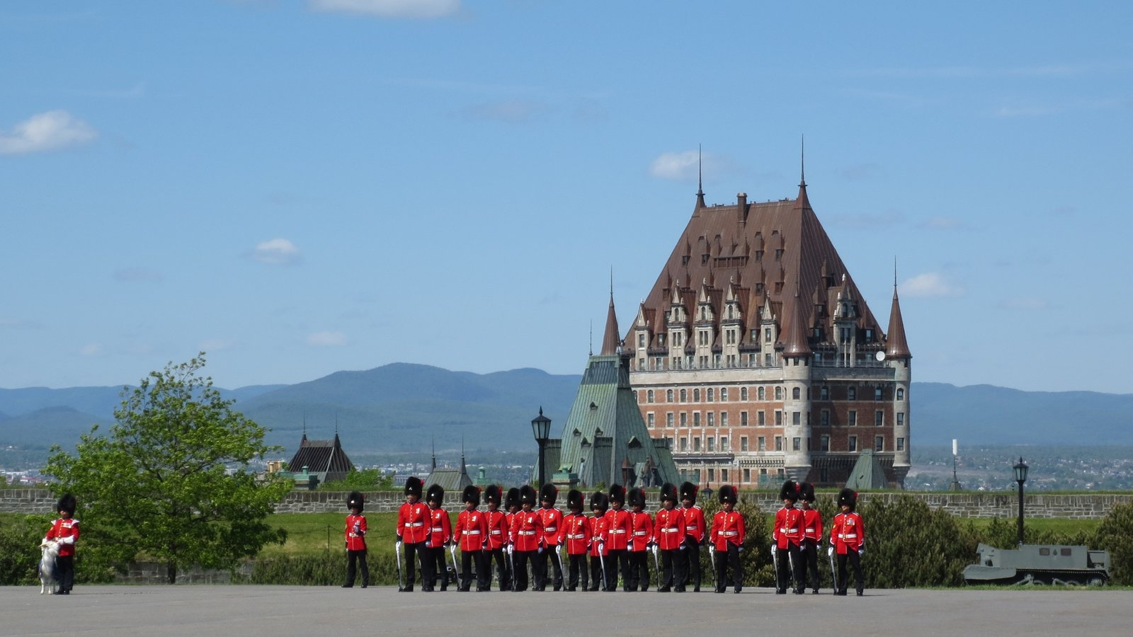 Quebec which includes chateau or palace as well as a large group of people