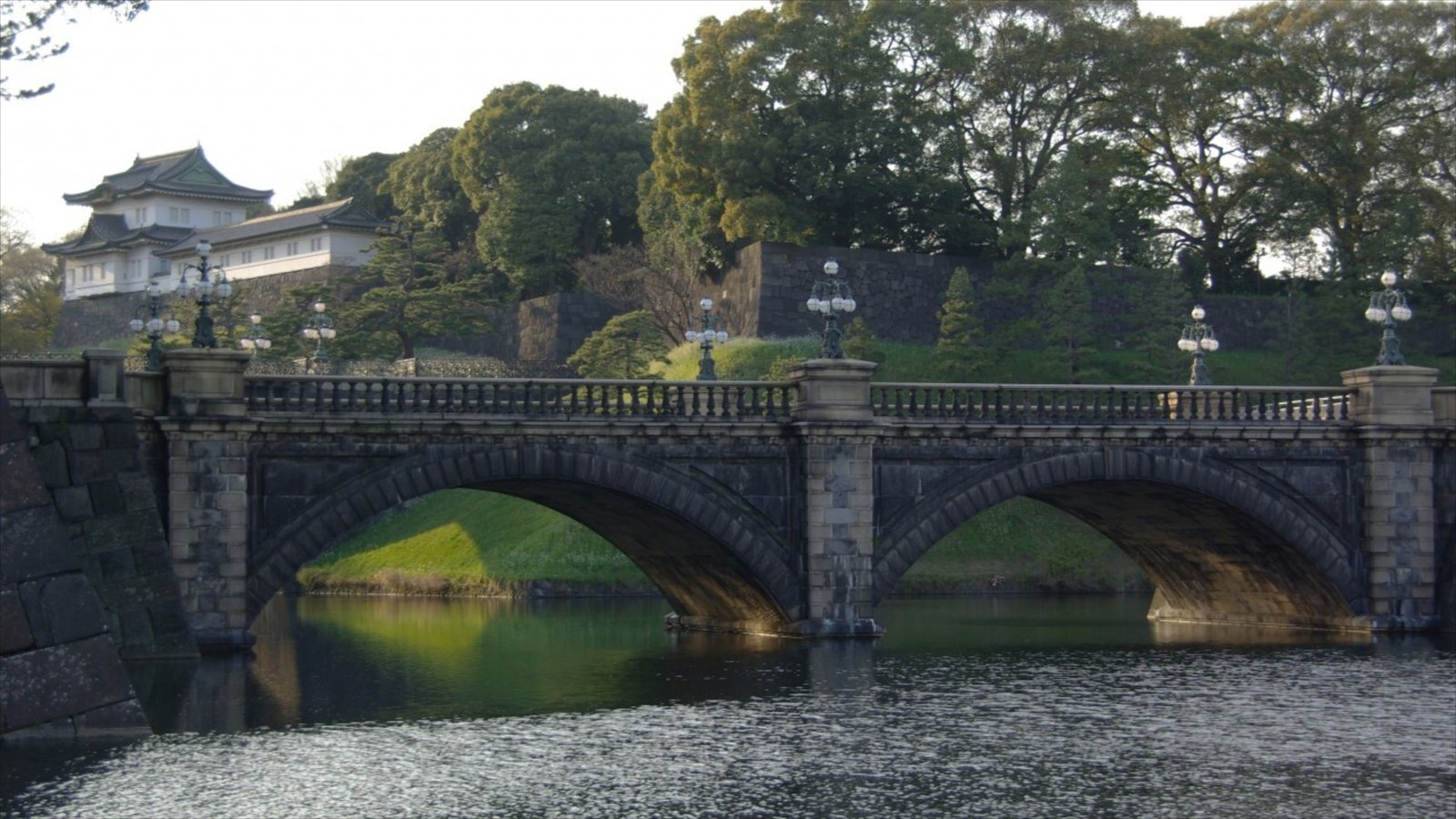 Tokyo Imperial Palace showing a lake or waterhole, a bridge and heritage elements